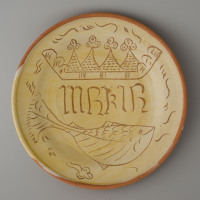 replica of a dish with christian symbols and the name of Maria / 1475-1525 / original in collection Museum Weesp