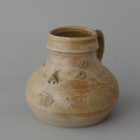 Left: an original cup made in Raeren ca. 1500, picture from Christies auction house. Right: a reconstruction