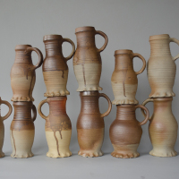 Left: reconstructions of jugs with engobe. Right: an original 14th century jug from Vianden castle