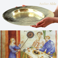 reconstruction of a brass dish after folio 65v from the Tacuinum Sanitatis in the national library in Paris (1390-1400 Milan)